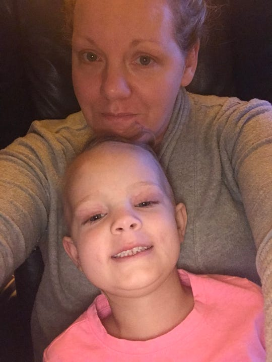 Lily Bown, 5, and her mother, Natasha, take a selfie. Lily lost her hair again after starting a new round of treatment for neuroblastoma, an aggressive childhood cancer.