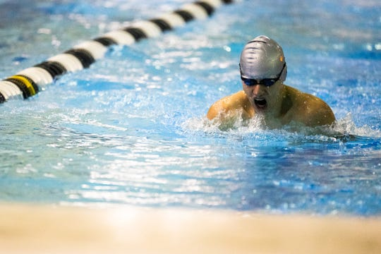 Bryce Smith of St. John's competes in the boys 200 yard medley relay at the Waverly Relays 2018 at East Lansing High School