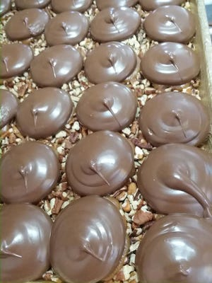 Homemade chocolate turtles made by Fudge & Frosting, opening at 333 S. Washington Square in downtown Lansing.