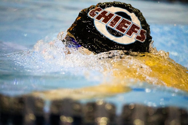 Okemos senior Eric Shen breaks the surface tension of the water during his stint in the boys 200 yard backstroke relay at the Waverly Relays 2018 at East Lansing High School.