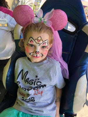 Lily Bowen, 5, as a queen kitty while visiting DisneyWorld in October 2018. Her cancer rebounded after the trip.