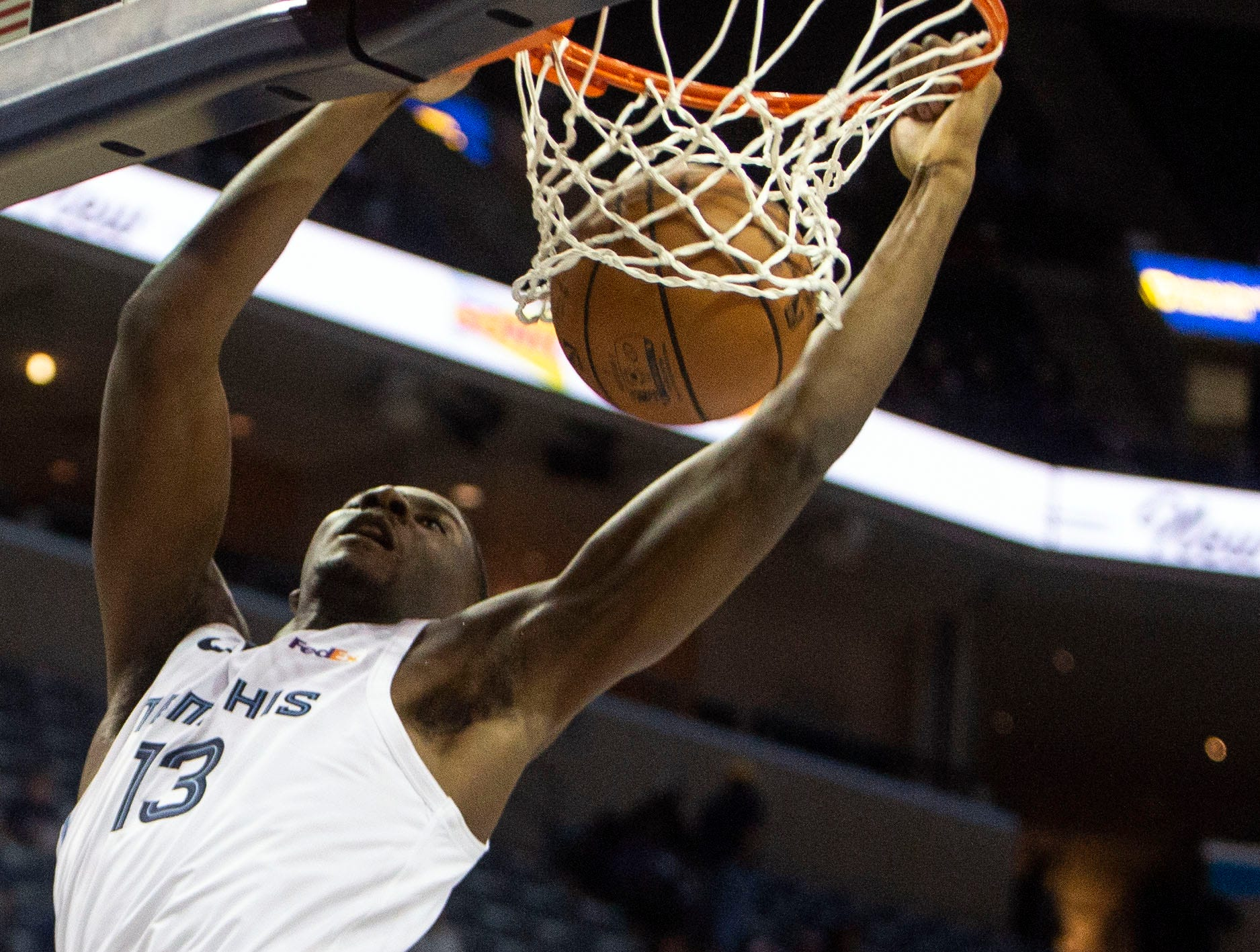 Memphis Grizzles forward Jaren Jackson Jr. (13) shoots over Los  Angeles Clippers center Marcin Gortat (13) during the first half of  a NBA basketball game between the Memphis Grizzlies and the  Los Angeles Clippers in the Fedex Forum, Wednesday, Dec. 5, 2018.
