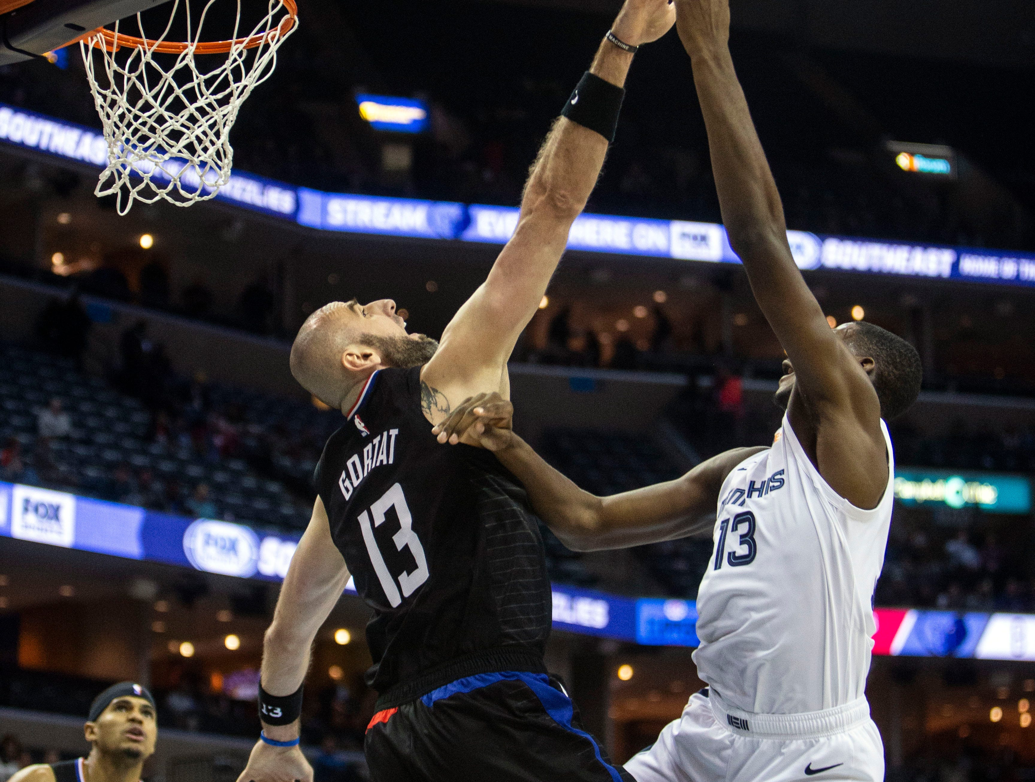 Memphis Grizzles forward Jaren Jackson Jr. (13) shoots over  Los Angeles Clippers Marcin Gortat (13) during the first half of a NBA basketball game between the Memphis Grizzlies and the  Los Angeles Clippers in the Fedex Forum, Wednesday, Dec. 5, 2018.