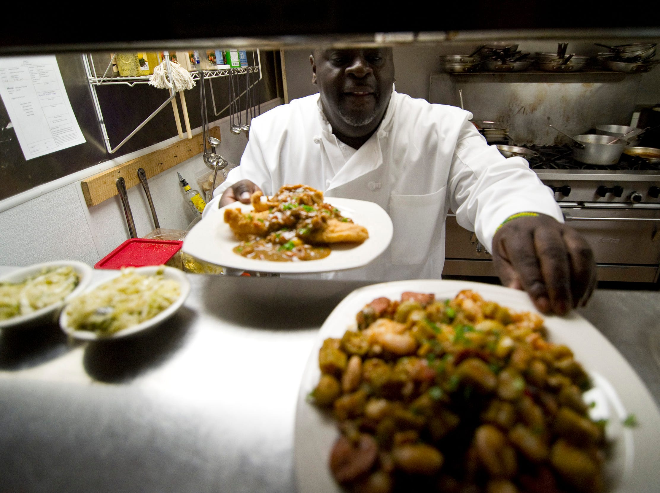Feb 21, 2014 - DejaVu Chef Gary Williams passes plates from the kitchen during lunch at his restaurant's downtown location on South Main St.