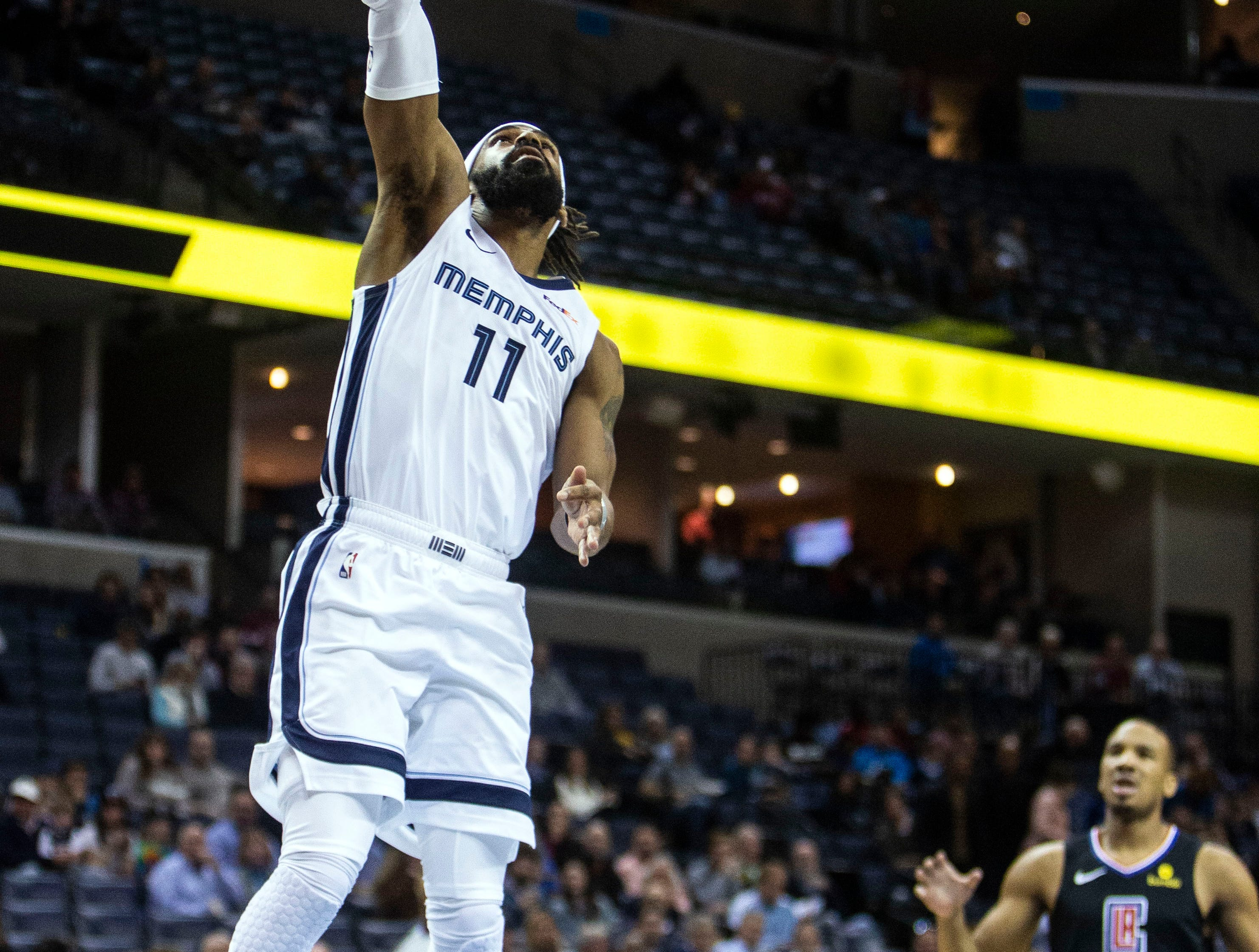 Memphis Grizzles guard Mike Conley (11) shoots during the first half of  a NBA basketball game between the Memphis Grizzlies and the  Los Angeles Clippers in the Fedex Forum, Wednesday, Dec. 5, 2018.