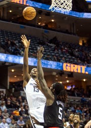 Memphis Grizzlies foward Jaren Jackson Jr. (13) shoots over Los Angeles Clippers forward Montrezl Harrell (5) during the first in a game between the Memphis Grizzlies and the Los Angeles Clippers in the Fedex Forum on Wednesday.