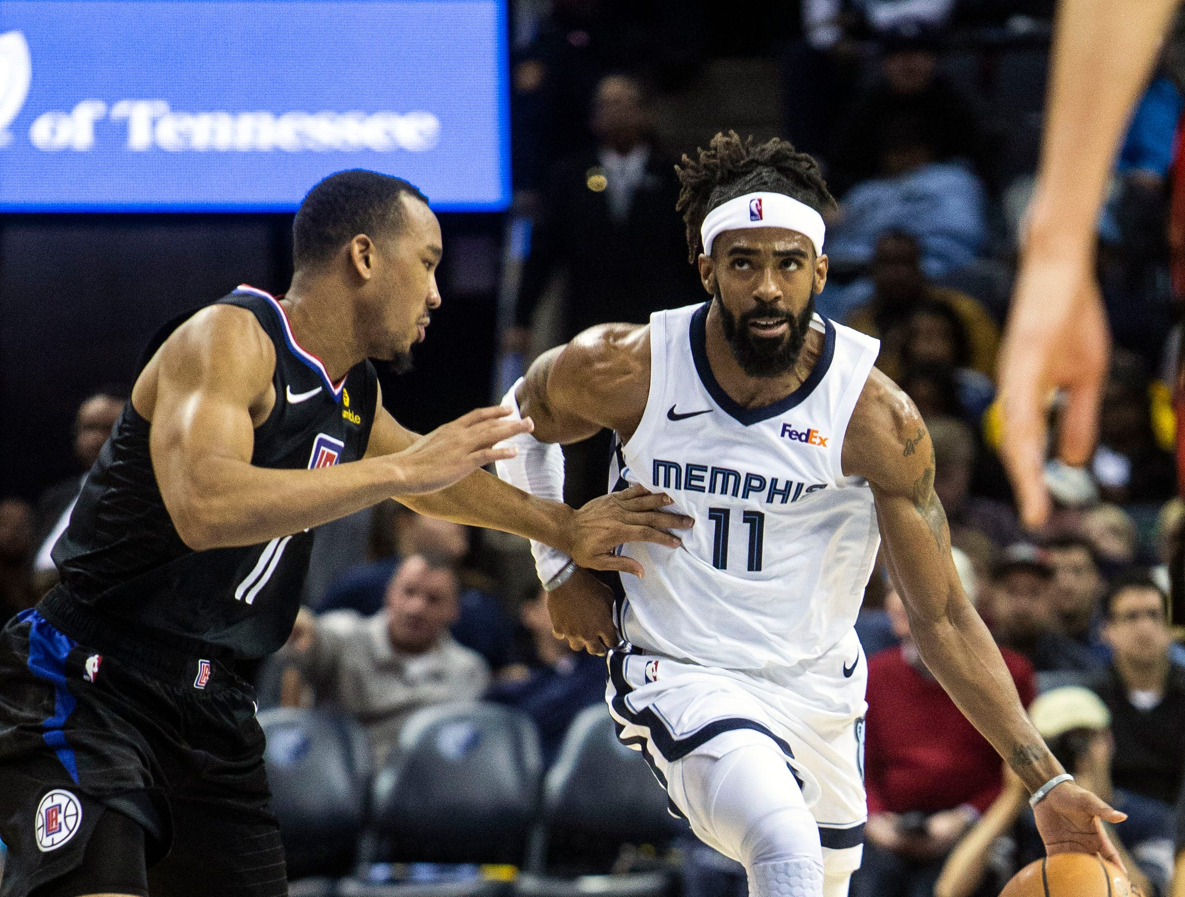 Memphis Grizzles guard Mike Conley (11) drives to the hoop during a NBA basketball game between the Memphis Grizzlies and the  Los Angeles Clippers in the Fedex Forum, Wednesday, Dec. 5, 2018.
