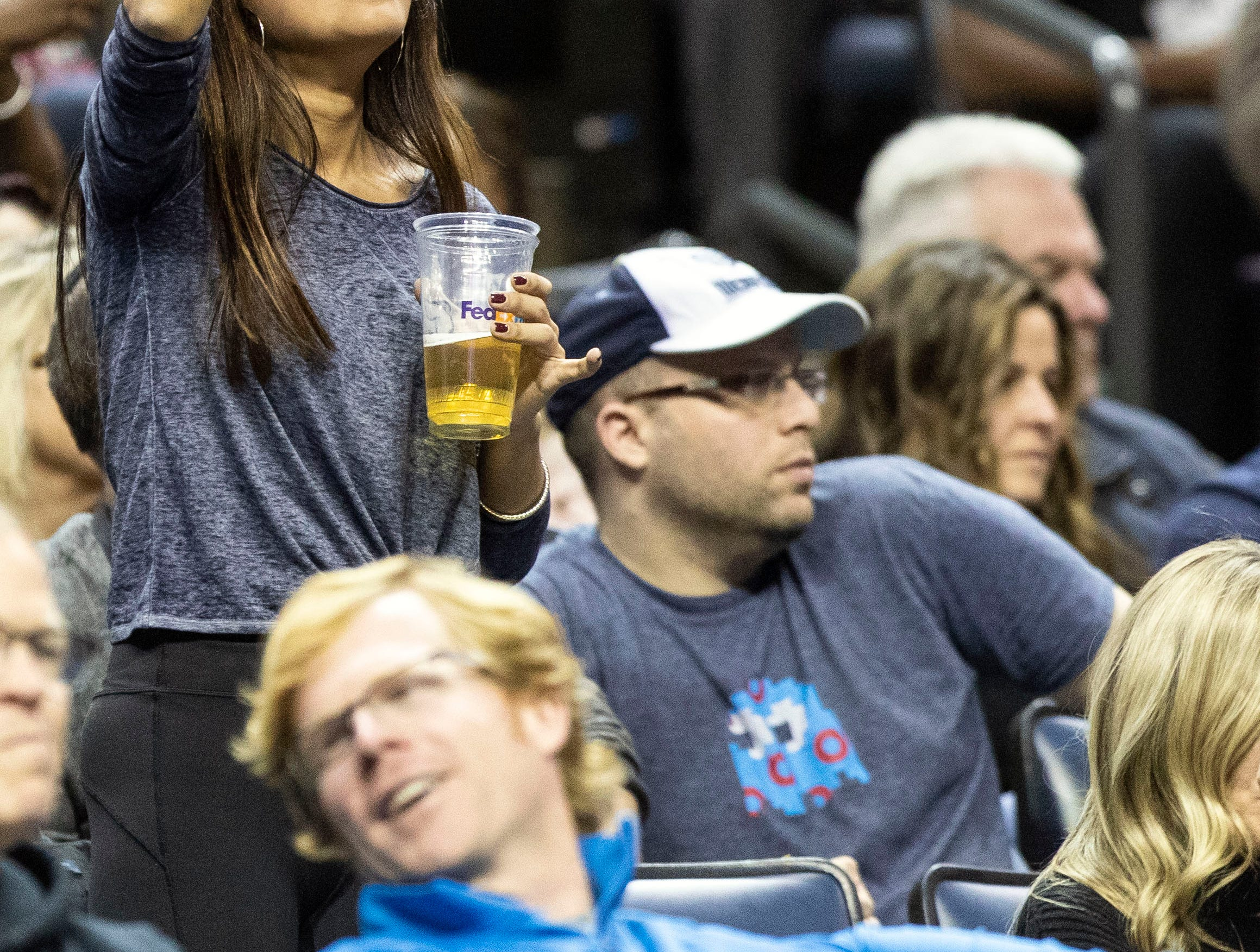 A Memphis Grizzles fan cheers in the stands during a NBA basketball game between the Memphis Grizzlies and the  Los Angeles Clippers in the Fedex Forum, Wednesday, Dec. 5, 2018.