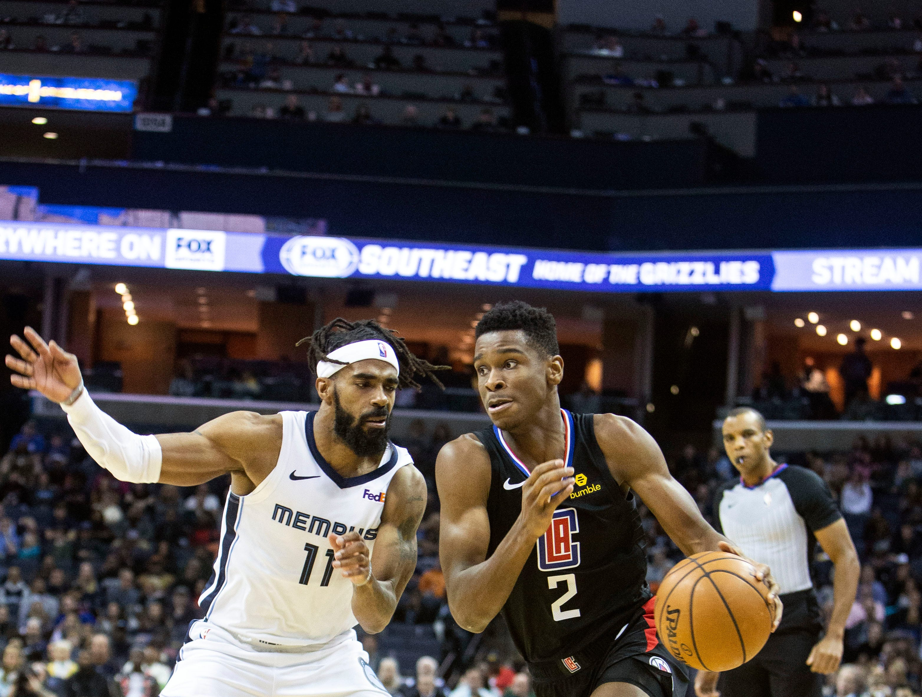 Memphis Grizzles guard Mike Conley (11) blocks Los Angeles Clippers guard Shai Gilgeous-Alexander (2) during a NBA basketball game in the Fedex Forum, Wednesday, Dec. 5, 2018.