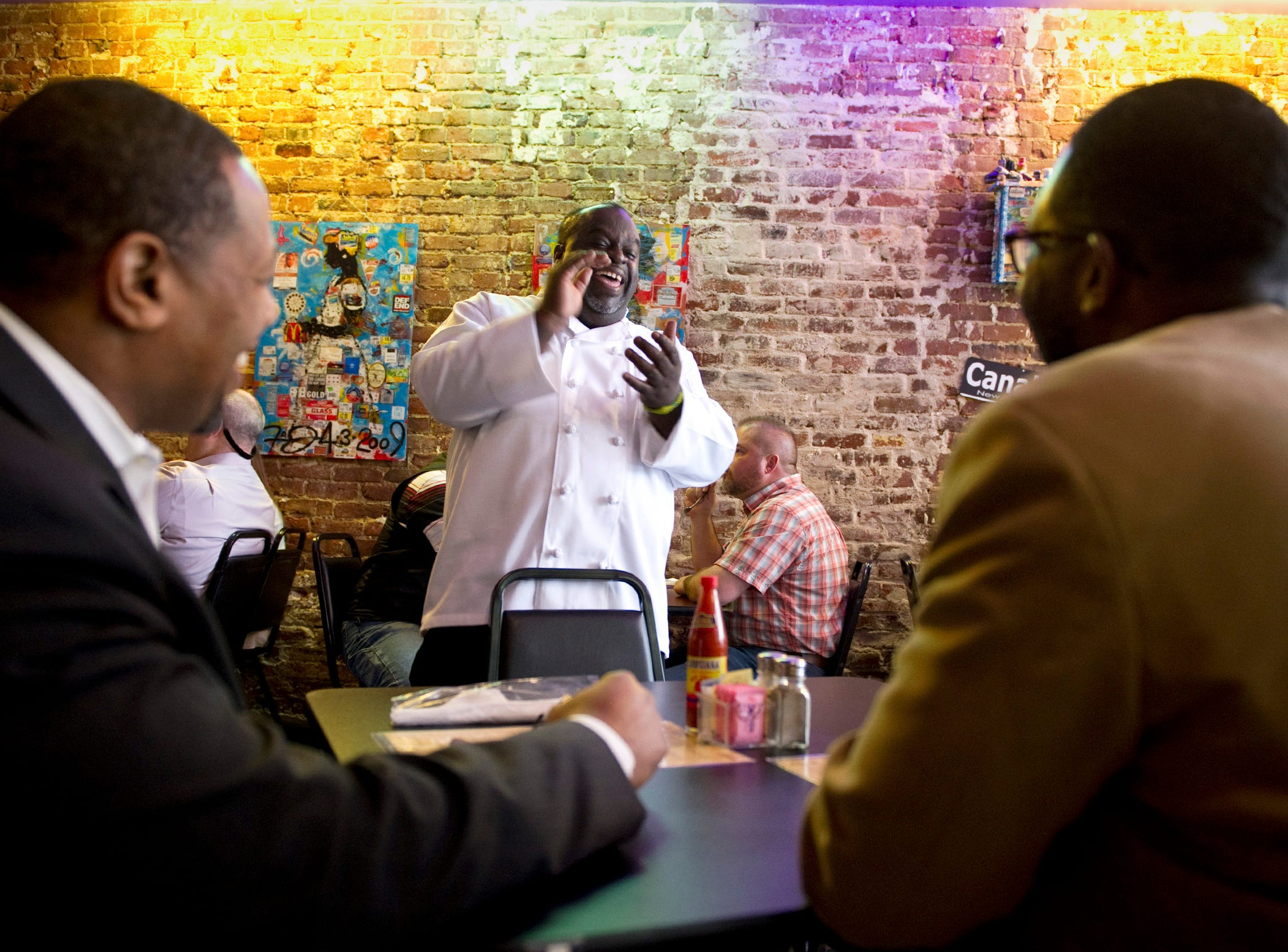 Feb 21, 2014 - DejaVu Chef Gary Williams jokes with customers Christopher Henry (left) and Darrell Pruitte during lunch at his restaurant's downtown location on South Main St.