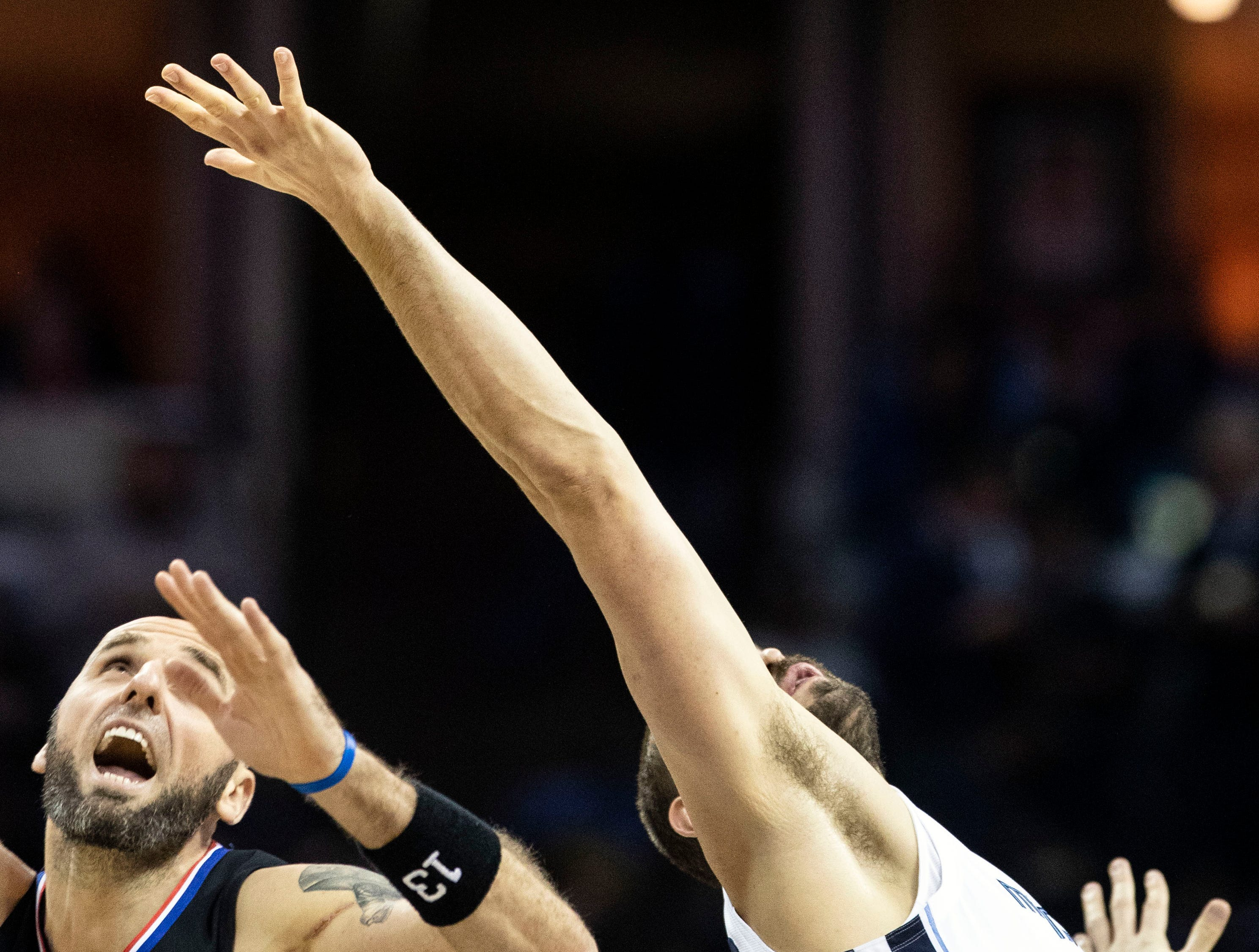 Memphis Grizzles center, Marc Gasol (33) and Los Angeles Clippers center Marcin Gortat (13) go up for a jump ball during a NBA game in the FedEx Forum , Wednesday, Dec. 4, 2018.
