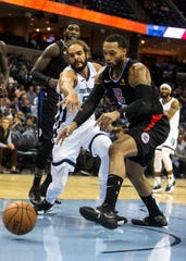Memphis Grizzles center Joakim Noah (55) battles Los Angeles Clippers forward Mike Scott (30) for a lose ball during the second half of a NBA basketball game in the Fedex Forum, Wednesday, Dec. 5, 2015.