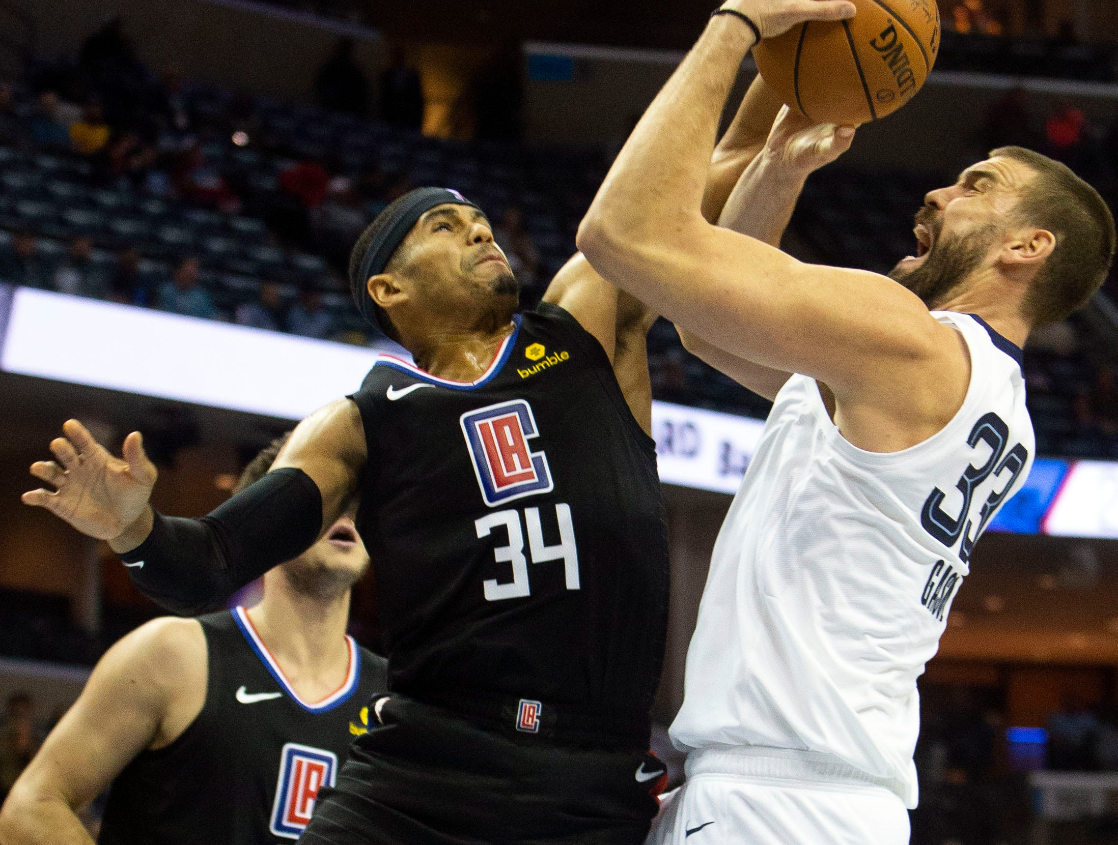 Memphis Grizzles center Marc Gasol (33) shoots over Los  Angeles Clippers forward Tobias Harris (34) during the first half of  a NBA basketball game between the Memphis Grizzlies and the  Los Angeles Clippers in the Fedex Forum, Wednesday, Dec. 5, 2018.