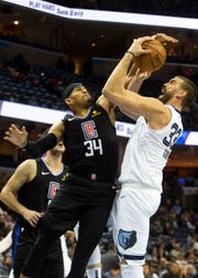 Memphis Grizzlies center Marc Gasol (33) shoots over Los Angeles Clippers forward Tobias Harris (34) during the first half at Fedex Forum on Wednesday.