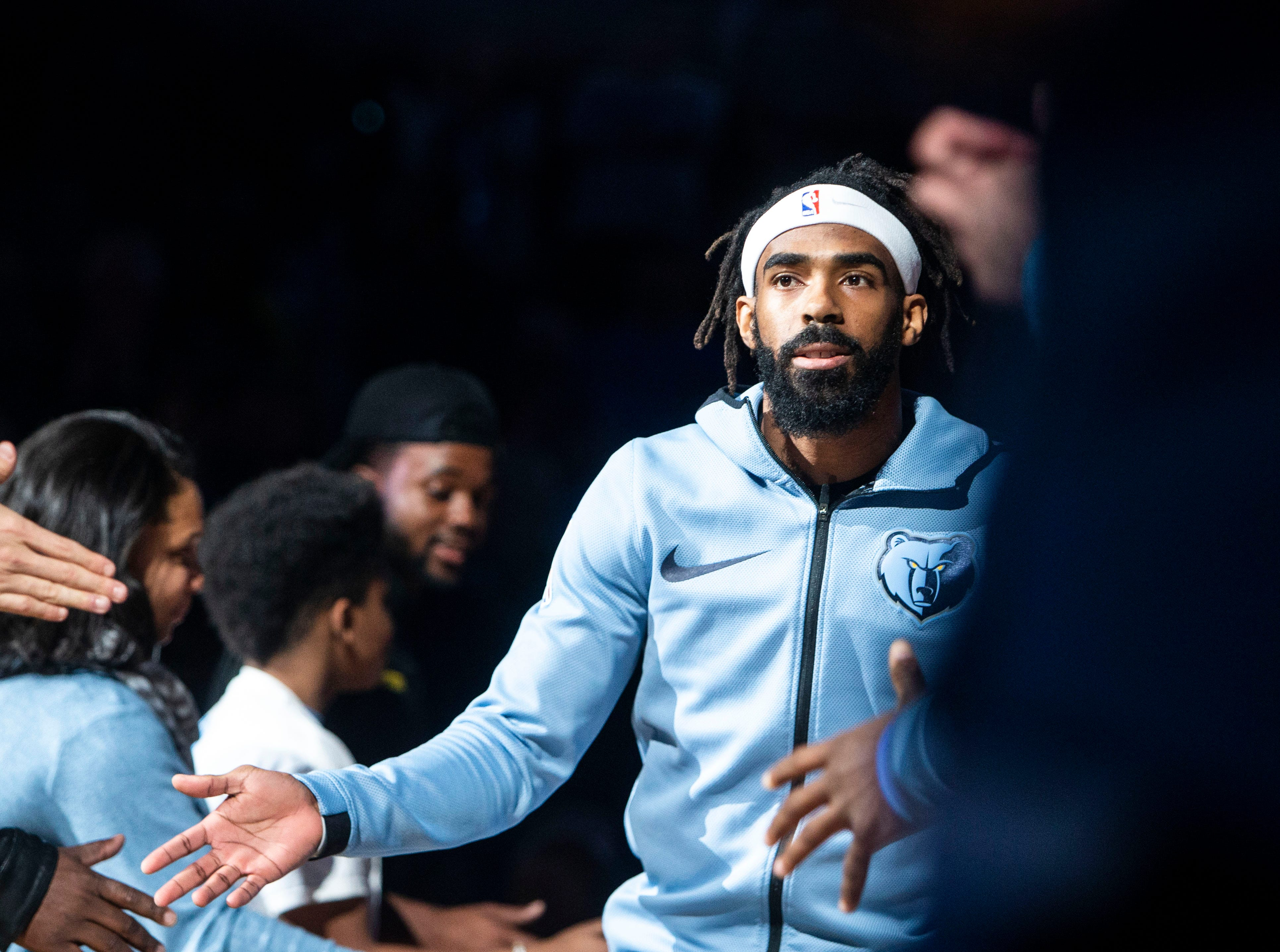 Memphis Grizzles guard Mike Conley (11) runs out on the court before a NBA basketball game between the Memphis Grizzlies and the  Los Angeles Clippers in the Fedex Forum, Wednesday, Dec. 5, 2018.