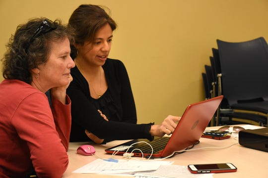 Certified Navigator Mokina Castro helps a consumer sift through the plan choices. The open enrollment period for health insurance under the ACA, or Affordable Care Act, expires Dec. 15.