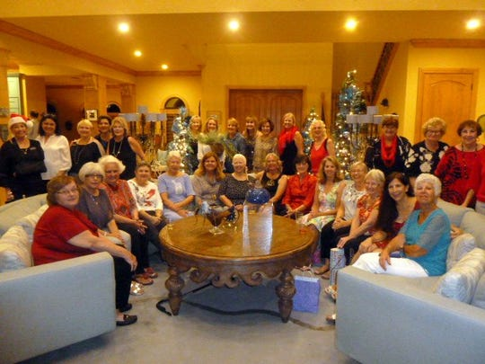 Calusa Garden Club of Marco Island members and spouses celebrated the season Dec. 2 at the Marco River home of president Sandy Wallen.
