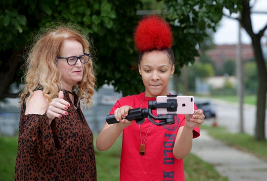 Nevaeh Rios, 14, assisted in shooting a public service announcement with Heather Perkins, founder of Ignite Change. Organizations will often welcome skilled help from volunteers.