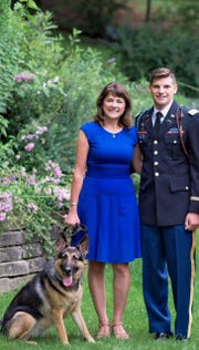 Former U.S. Senate candidate Leah Vukmir stands with her son Nicholas Vukmir. The Wauwatosa native was the  honor guard cordon commander during former President George H.W. Bush's funeral on Dec. 5.