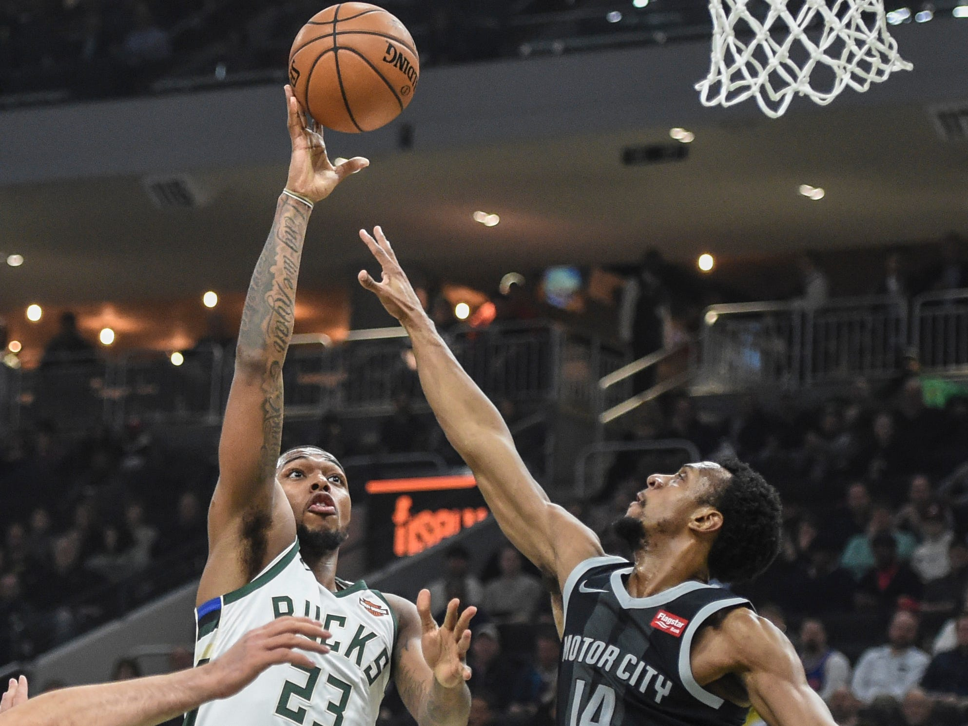 Sterling Brown of the Bucks, going up for a shot against the Pistons' Ish Smith, saw extended playing time on Wednesday with the absence of Khris Middleton and finished with 11 points in 19 minutes.