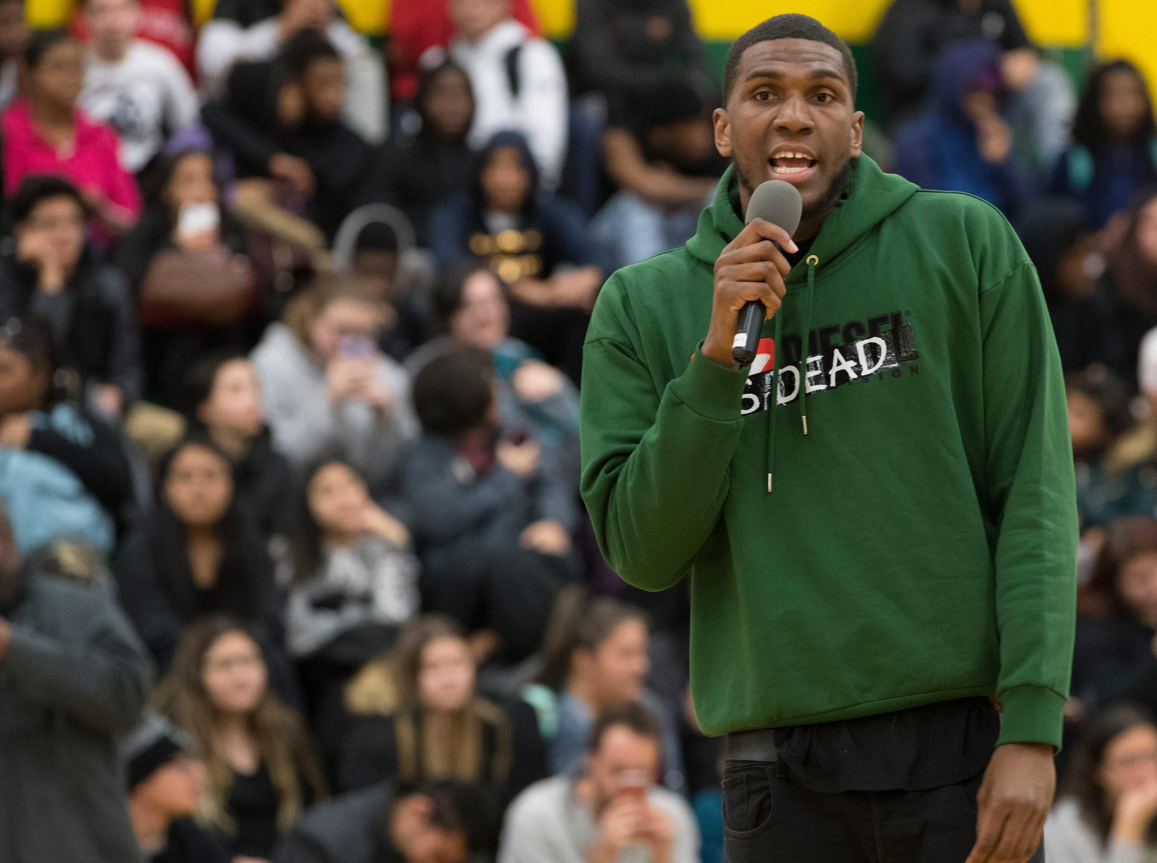 Golden State Warrior center Kevon Looney talks to students while taking part in a ceremony where his jersey is retired  Thursday, December 6, 2018 at Hamilton High School.