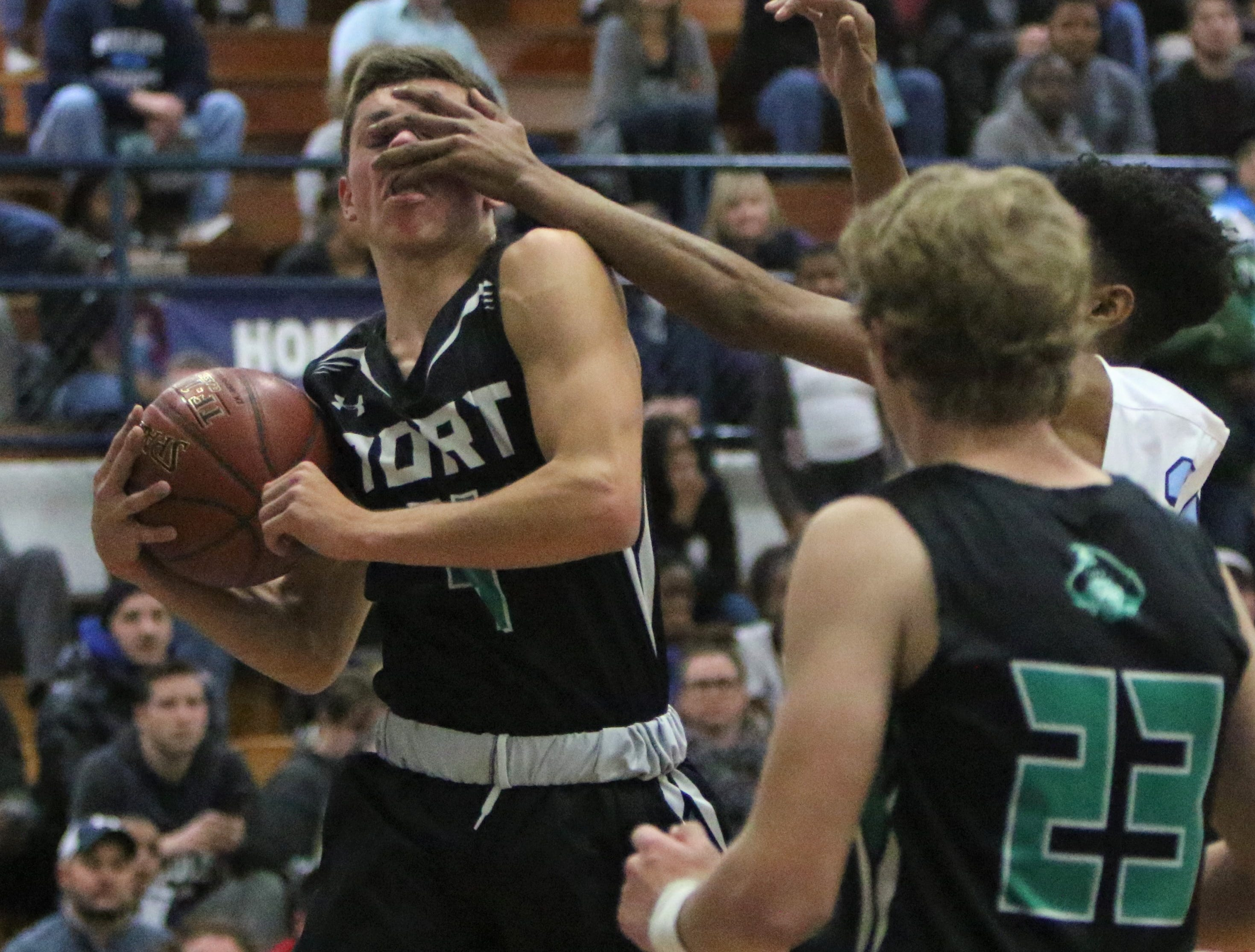 Port Washington guard Adam Baierl gets hit in the face while coming down with a rebound against Nicolet on Wednesday, Dec. 5.