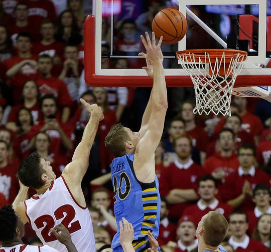 Marquette center Luke Fischer tips in the winning basket with 26 seconds left during Marquette's 57-55 win over Wisconsin in 2015 in Madison.