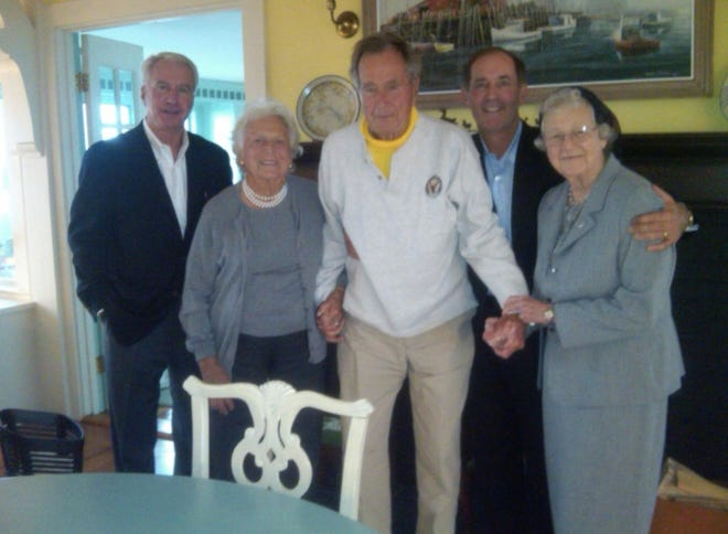 Longtime Cardinal Stritch University President Sister Camille Kliebhan (right) dreamed of having lunch with former President George H.W. Bush and his wife, Barbara. Milwaukee businessman Joe Sweeney (second from right) made it happen in September 2011 at the Bushes' summer home in Kennebunkport, Maine. At far left is Sweeney's friend, Chris Doerr, who provided jet transportation for the trip.