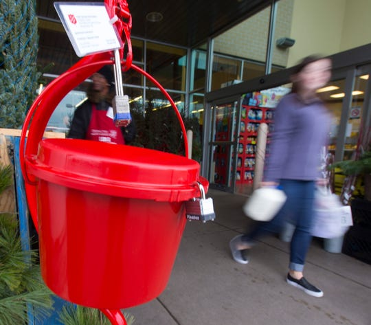 Patrons pass a Salvation Army kettle outside Pick 'n Save in Glendale in this 2016 file photo. Cash donations go a long way at charitable organizations.
