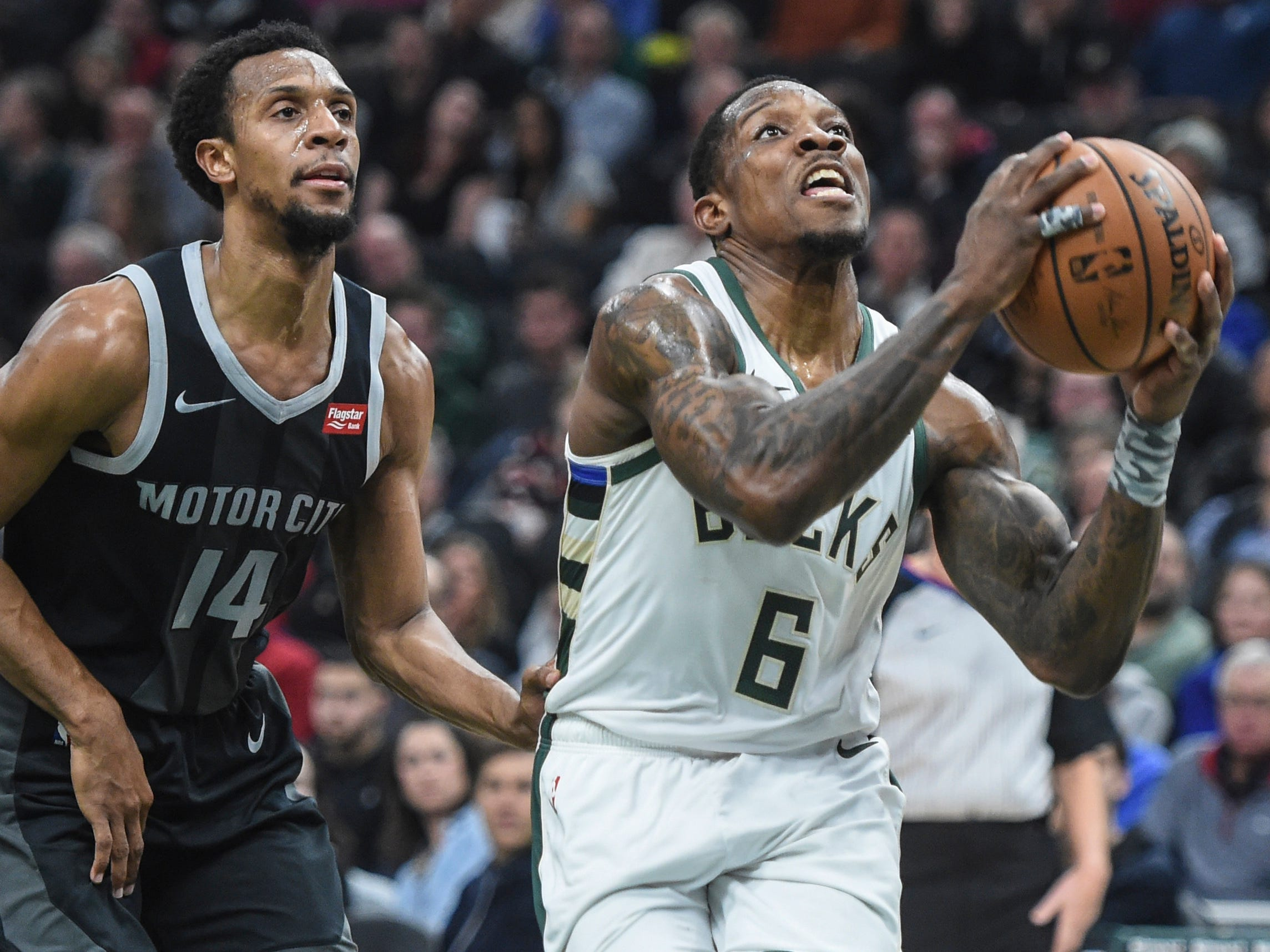 Bucks guard Eric Bledsoe gets past Pistons guard Ish Smith on a drive to the basket that netted him two of his team-high 27 points on Wednesday night at Fiserv Forum.