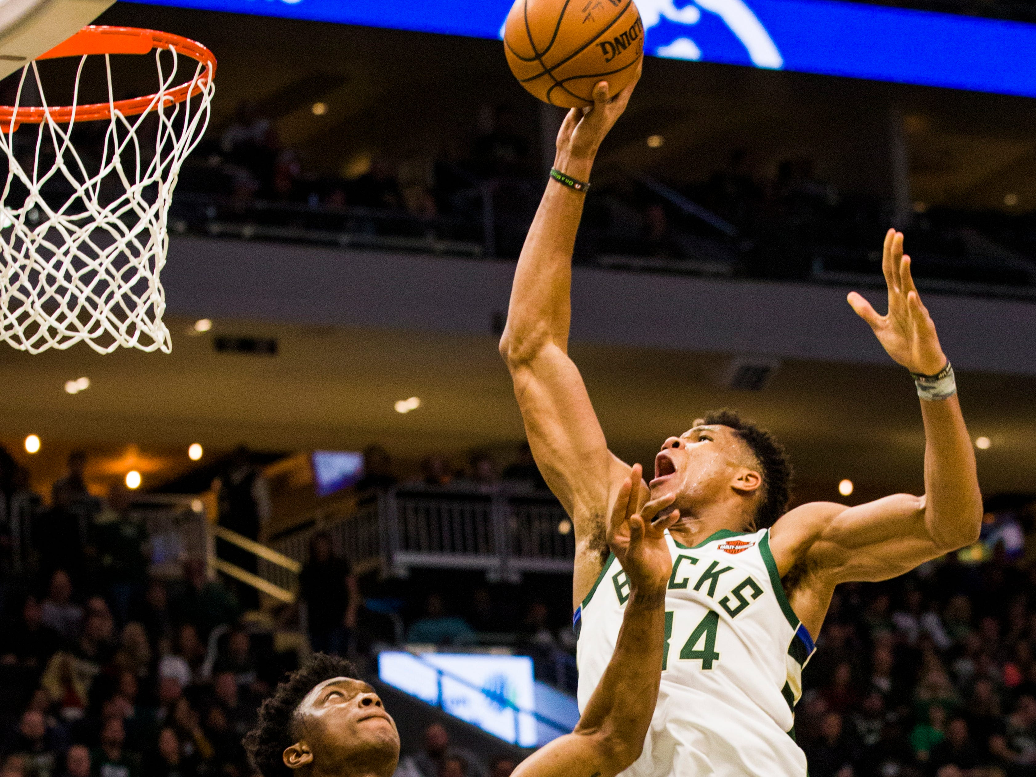 Bucks forward Giannis Antetokounmpo gets ready to thrown down a dunk over the Pistons' Stanley Johnson on Wednesday night.