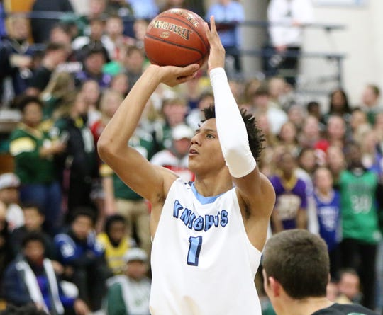 Nicolet junior Jalen Johnson shoots a free throw during the team's first meeting with Port Washington on Dec. 5, 2018.