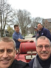 Taking a recent ride in the 1930 fire truck are (from left, front) Steve Bane, retired West Allis fire chief;John Esche, current truck owner; (rear) David Bandomir, West Allis Fire Department captain; West Allis Assistant Fire Chief Kurt Zellmann; and West Allis firefighter Scott Liska (with FDNY hat). Liska's grandfather was a member of the West Allis Fire Department and rode the same engine.
