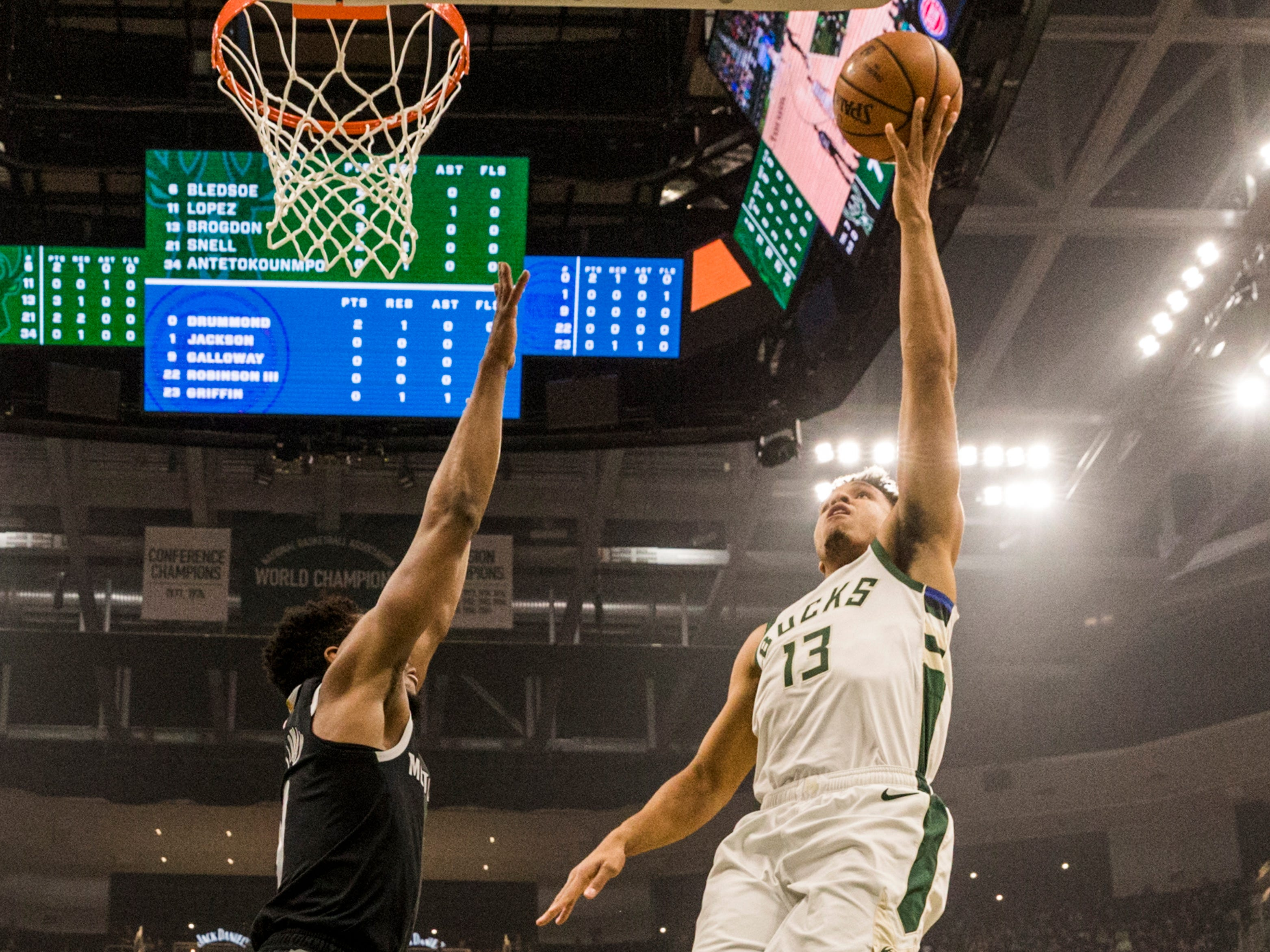 Bucks guard Malcolm Brogdon goes in for a layup against Langston Galloway of the Pistons on Wednesday night.