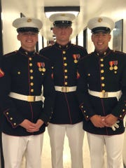 Lance Cpl. Casey Schuetz (left),  a 2017 Brookfield Central High School graduate  stands with two other members of the U.S. Marine Corps, Sean Jones (center) and Oscar Selbera of Racine. Selbera and Schuetz were both a part of George H.W. Bush's funeral.