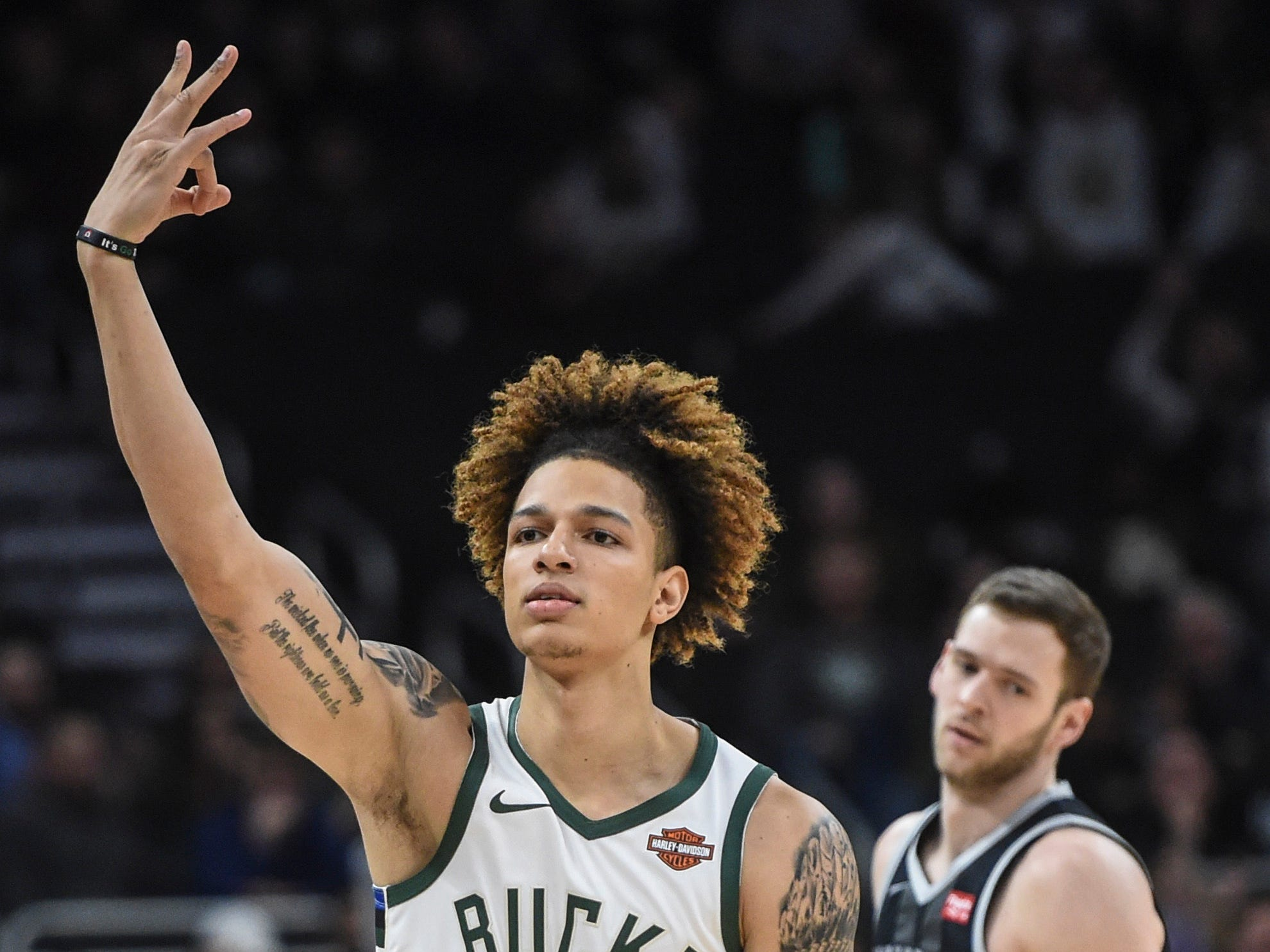 Bucks forward D.J. Wilson, playing in his first game this season, reacts after knocking down a three-pointer against the Pistons on Wednesday night.