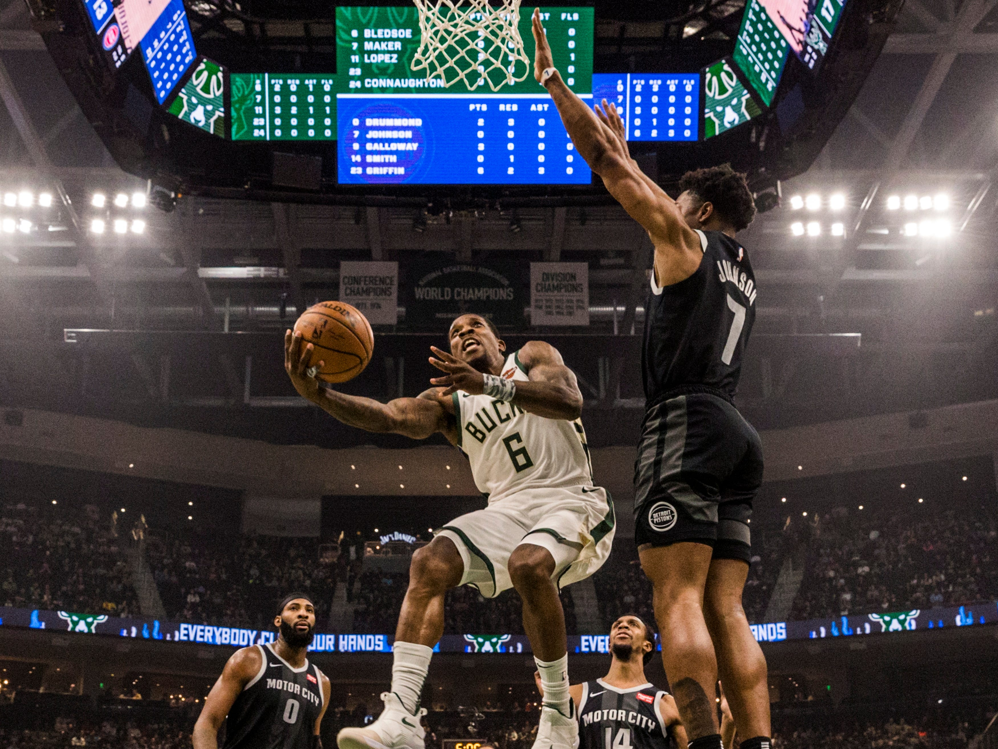 Eric Bledsoe of the Bucks ducks under the defense of the Pistons' Stanley Jackson as he goes up for two of his team-high 27 points on Monday night at Fiserv Forum.