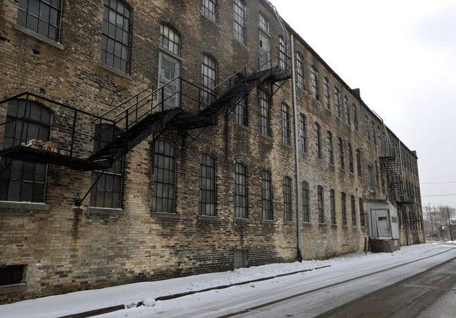 In the heart of Racine's manufacturing district lies the Old Gold Medal Camp Furniture Mfg company, a 1900's era manufacturer.  Racine's urban center registers some of Wisconsin's highest scores for economic distress as well as exposure to traumatic experiences.