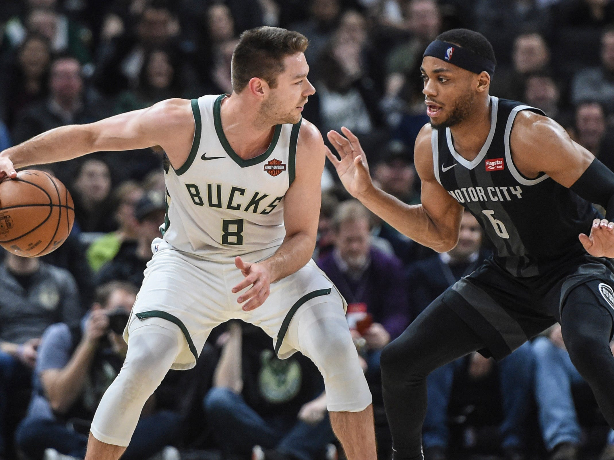 Bucks guard Matthew Dellavedova works against Bruce Brown of the Pistons during the fourth quarter Wednesday night.