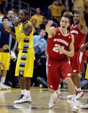 Wisconsin's Josh Gasser reacts after a late Marquette turnover with Dwight Buycks in the background in 2010 in Milwaukee.