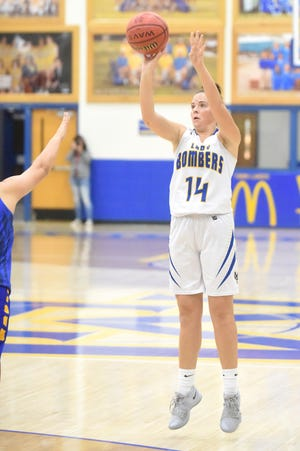 Mountain Home's Kyra Pinn launches a 3-point attempt during a recent game at The Hangar.