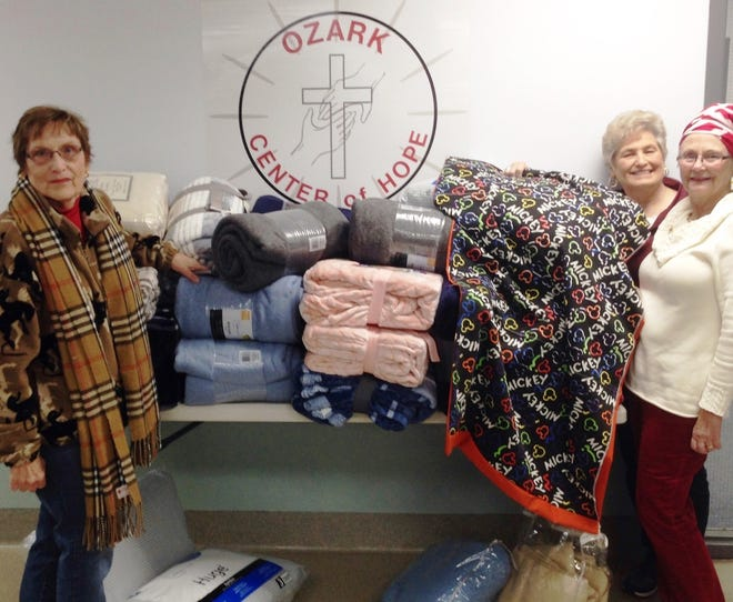The Ozark Center of Hope recently accepted blankets and sleeping bags from Needs of Many, which were collected during October and November during the Warm Someone's Heart campaign. Pictured are: (from left)Bette Gould, Needs of Many; Sandra Anderson, Ozark Center of Hope; and Carolyn Densmore, Needs of Many.