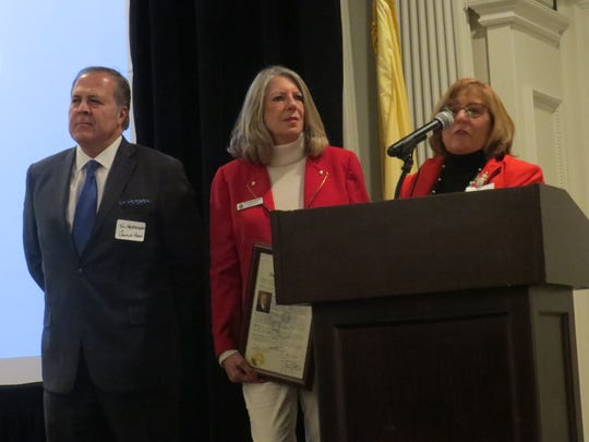 Morris County freeholders Tom Mastrangelo, Debra Smith and Kathy DeFillippo present a proclimation during a retirement reception for Morris County Chamber of Commerce President Paul Boudreau, at the Park Savoy in Florham Park. Dec. 5, 2018.