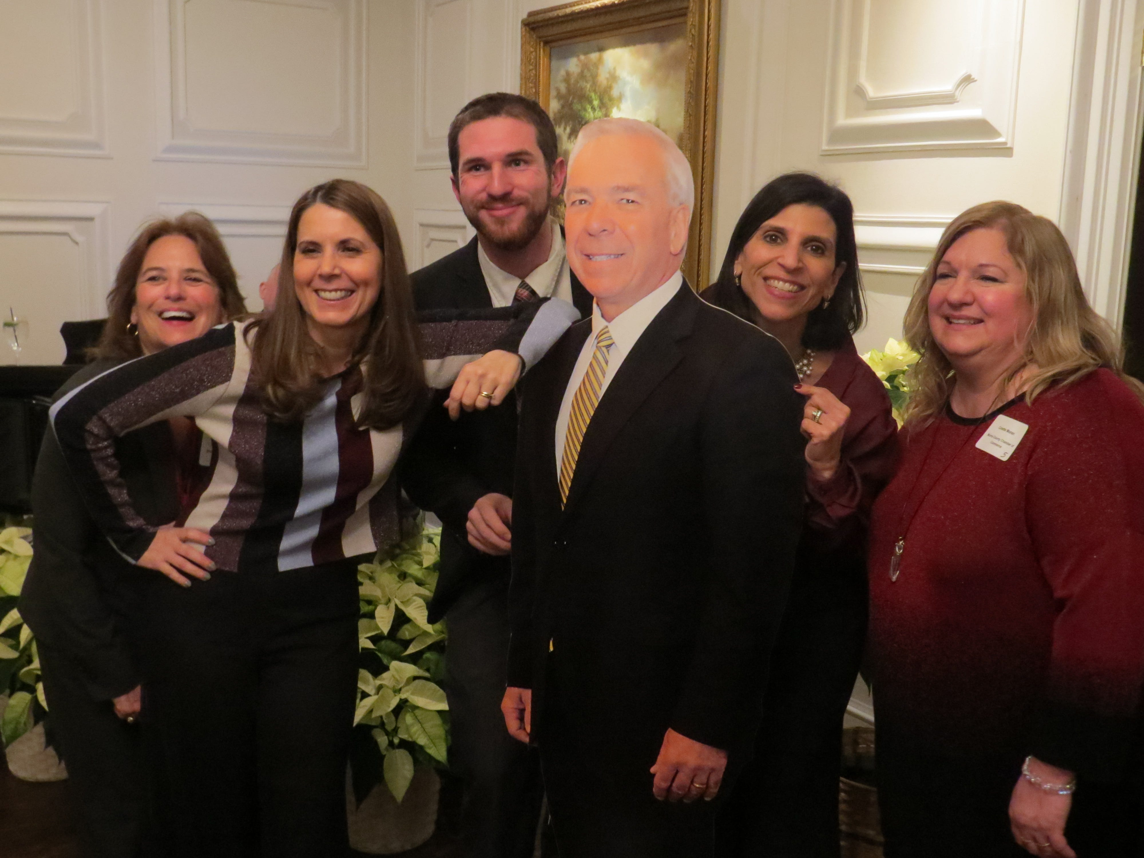 Morris County Chamber of Commerce staff members pose with a life-size cutout of chamber President Paul Boudreau, during a retirement reception for Boudreau at the Park Savoy in Florham Park. Dec. 5, 2018.