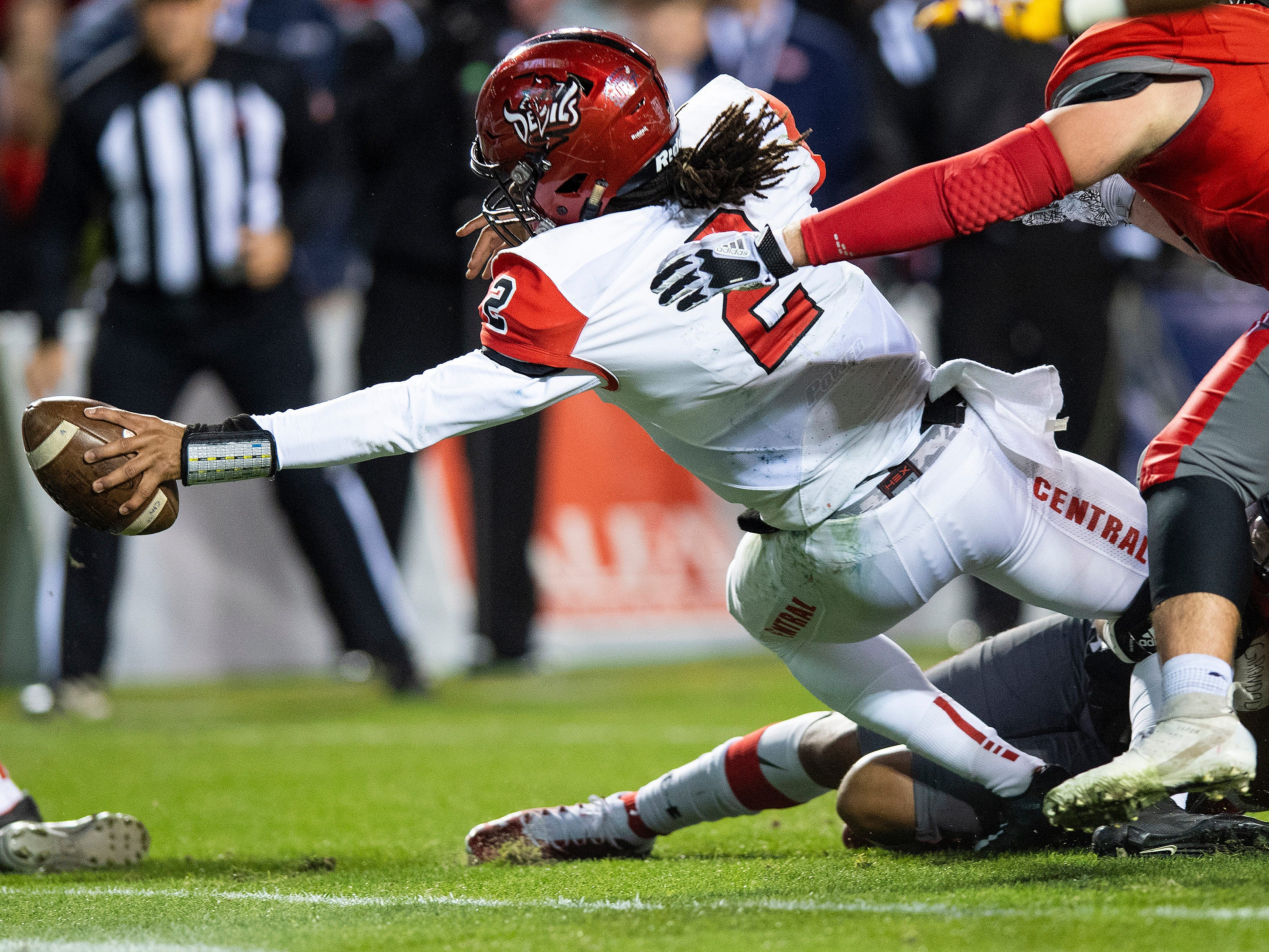 Central-Phenix City's Peter Parrish reaches the ball over the goal line for a touchdown against Thompson during the AHSAA Class 7A State Championship Football Game at Jordan Hare Stadium in Auburn, Ala., on Wednesday evening December 5, 2018.