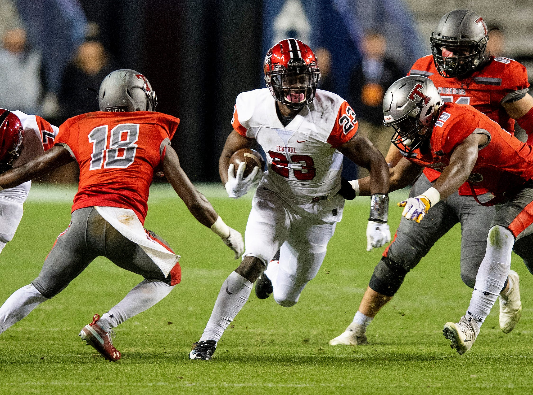 Central-Phenix City's Joseph McKay carries the ball against   Thompson during the AHSAA Class 7A State Championship Football Game at Jordan Hare Stadium in Auburn, Ala., on Wednesday evening December 5, 2018.