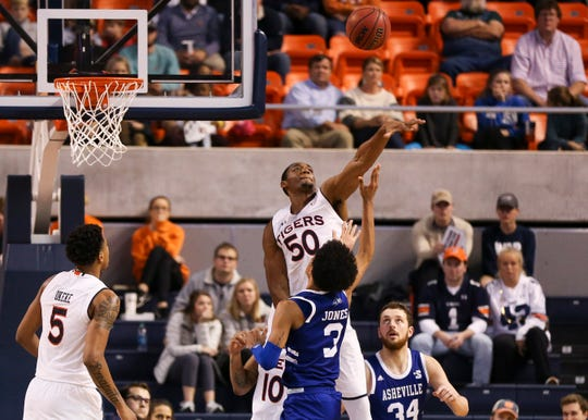 Auburn center Austin Wiley (50) blocks a shot against UNC Asheville on Dec. 4, 2018, in Auburn, Ala.