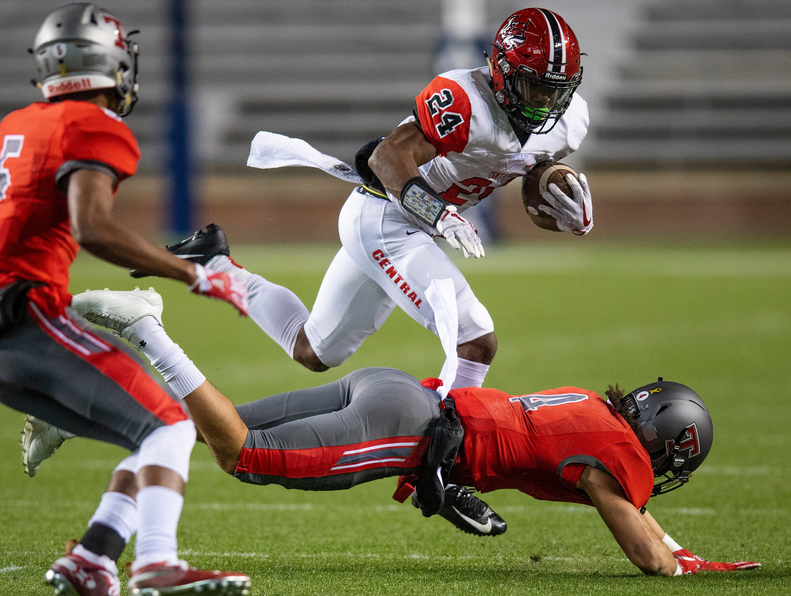 Central-Phenix City's Amontae Spivey is tripped up by Thompson's Jalen Bustamonte during the AHSAA Class 7A State Championship Football Game at Jordan Hare Stadium in Auburn, Ala., on Wednesday evening December 5, 2018.