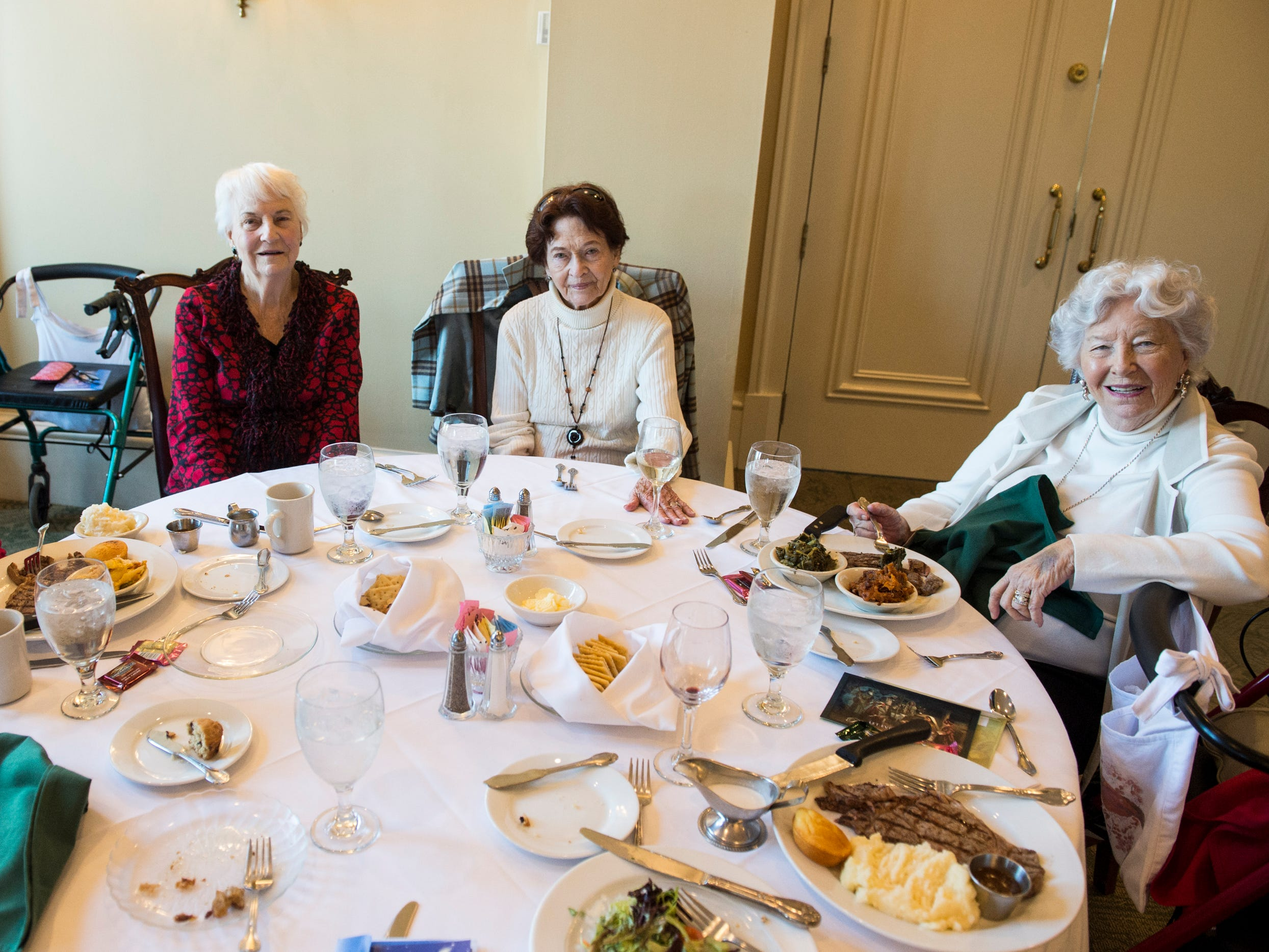 Alice Tyson, from left, Dot Hawthorne, Peggy Joseph and Maureen Parks pose for a picture during lunch at Montgomery Country Club in Montgomery, Ala., on Wednesday, Dec. 5, 2018.