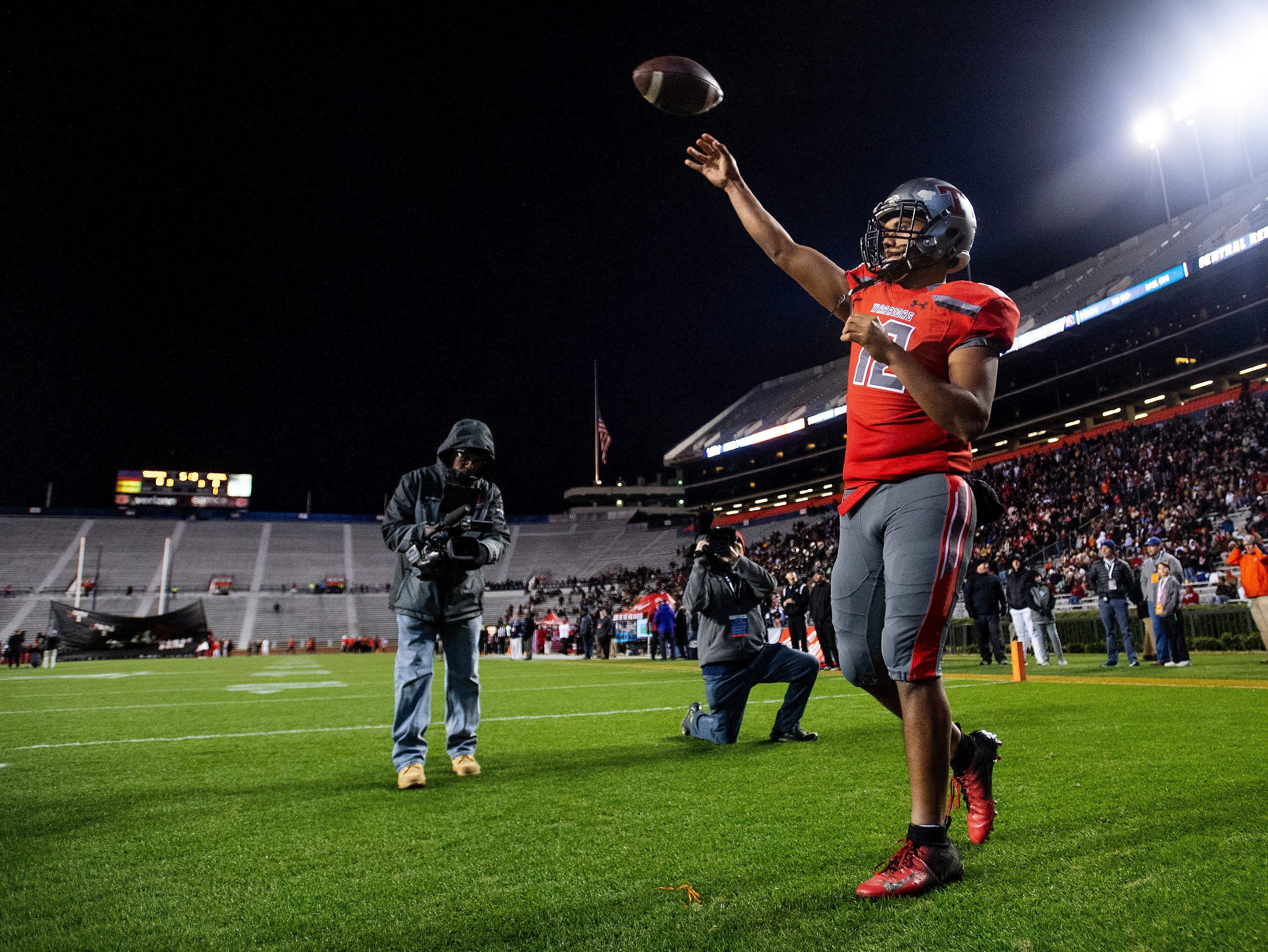 Thompson's Taulia Tagovailoa warms up before the AHSAA Class 7A State Championship Football Game at Jordan Hare Stadium in Auburn, Ala., on Wednesday evening December 5, 2018.